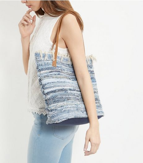 http://media1.newlookassets.com/i/newlook/369472449D3/womens/bags-and-purses/tote-shopper-bags/blue-rolled-denim-fray-trim-shopper-bag-/?$plp_3_row$