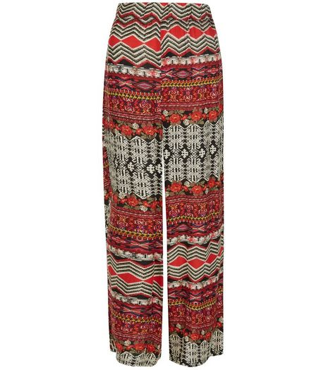 Mela Red Aztec Print Flared Trousers | New Look