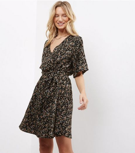 Black Ditsy Floral Wrap Front Mini Dress  | New Look