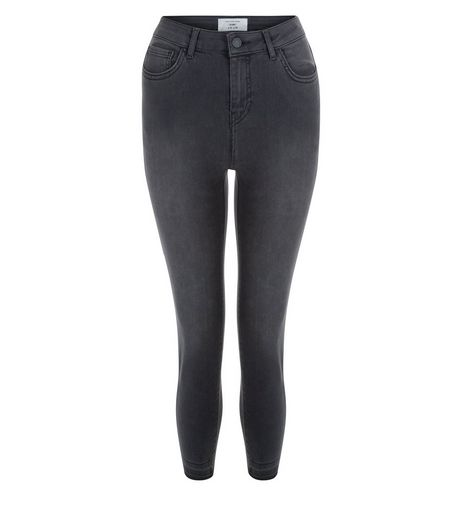 Petite Black Washed Drop Hem Skinny Jeans  | New Look