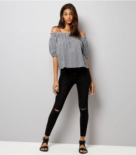 Black Ripped Knee Angled Hem Skinny Jeans  | New Look