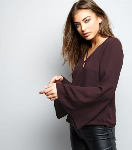 Dark Purple Lattice Front Wrap Front Flare Sleeve Top | New Look