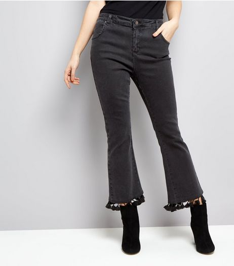Black Pom Pom Trim Flared hem Jeans  | New Look