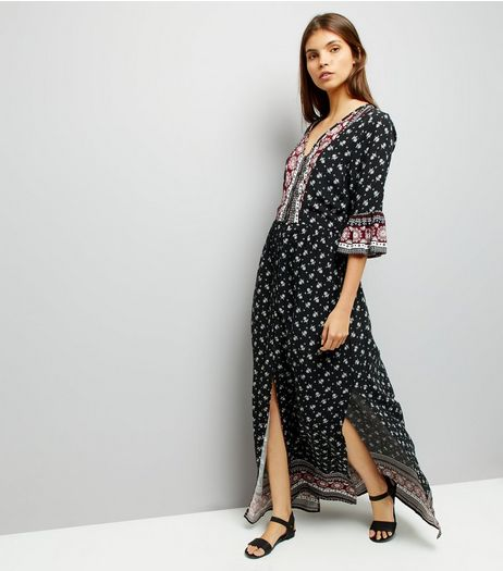 Black Floral Print Bell Sleeve Maxi Dress | New Look
